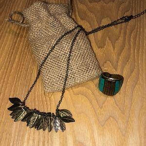 Feather necklace and statement ring